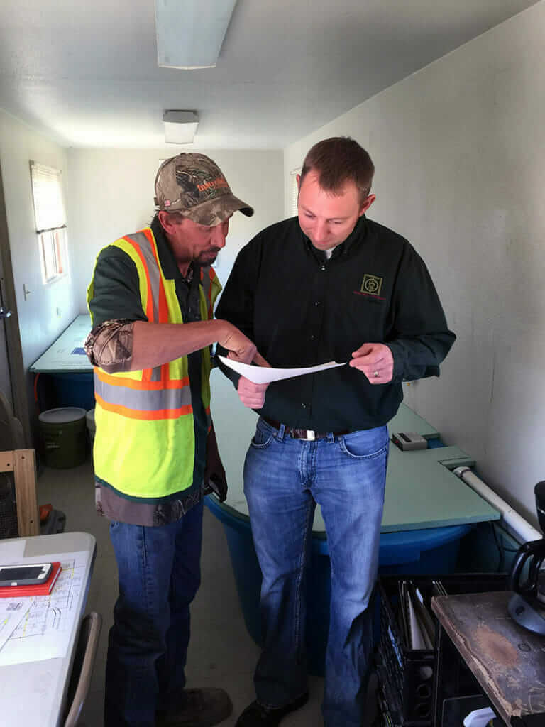 Materials Testing Consultants employees reviewing project blueprints